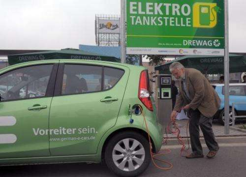 A man charges his electric car