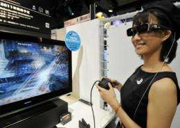 A model demonstrates a 3D videogame content for PlayStation 3 videogame console at the Tokyo Game Show