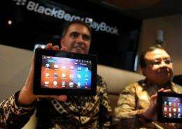 An official from Research in Motion (RIM) Indonesia displays a BlackBerry PlayBook