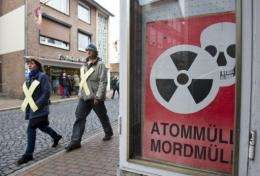 Anti-nuclear prosters in Dannenberg, Germany, today pass a sign saying: