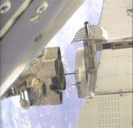 Astronauts install big magnet on space station (AP)