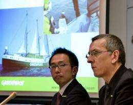 Greenpeace safety advisor Jan van de Putte of Belgium and Greenpeace Japan executive director Junichi Sato