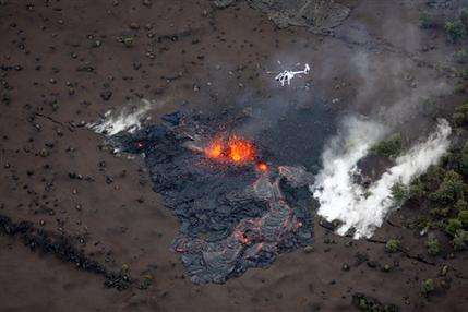 Lava spews 100 feet from Hawaii volcano's new vent (AP)