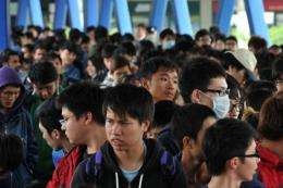 People line up for the Apple iPhone 4s in Hong Kong