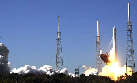 SpaceX's Falcon 9 rocket lifts off in 2010 to launch the Dragon space capsule into orbit