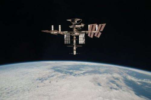 The International Space Station and the docked space shuttle Endeavour flying at an altitude of approximately 220 miles