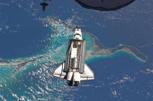 The Space Shuttle Atlantis as it approaches the International Space Station