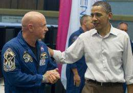 US President Barack Obama speaks with Astronaut Mark Kelly at the Kennedy Space Center