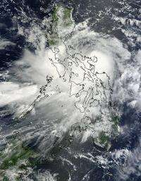 NASA sees Tropical Storm Nock-ten knocking the Philippines