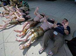 Adam Ghiggio from Australia poses next to mutant mannequins wich are lined up to be used as displays for