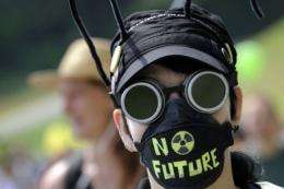 A demonstrator attends a protest in Dottingen, northern Switzerland against nuclear power