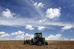 A farmer plants corn in Luxemburg, Iowa