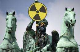 A Greenpeace activist places an anti-nuclear sign on top of the Brandenburg Gate in Berlin