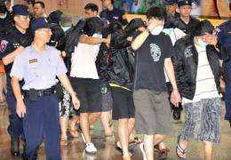 A group of Taiwanese nationals arrested in Indonesia for alleged online fraud arrive at Taoyuan airport