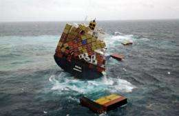 A handout photo taken on October 12 shows containers floating near the grounded container ship 'Rena