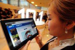 A model holding Samsung Electronics' new tablet computer, the Galaxy Tab 10.1, during its launch in July