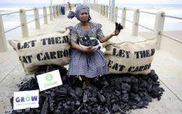 An Oxfam activist stages a protest at the climate change talks in Durban