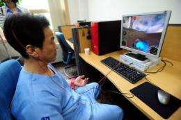 A nurse at the Save Brain Clinic demonstrates the process of neuro-feedback at Gongju National Hospital in South Korea