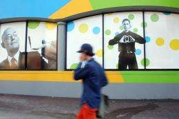 A pedestrian walks past a shop of New Zealand company Telecom New Zealand in Auckland
