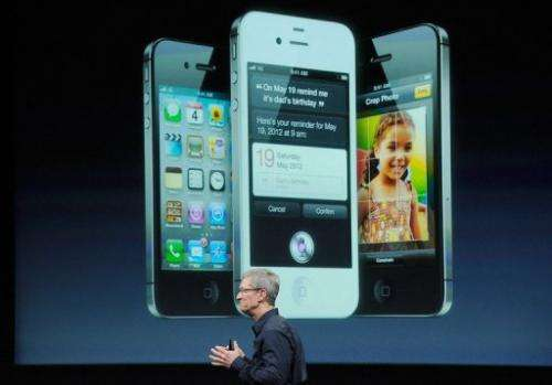 Apple CEO Tim Cook speaks at the event introducing the new iPhone 4s