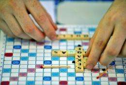 A Scrabble player displays his letters under a giant tent during the 37th World Scrabble Championships in Dakar