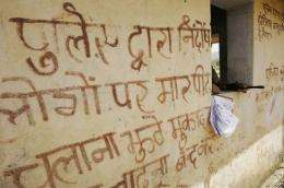 A slogan in Hindi on a wall in Tundi, in India's Jharkand state, says: