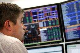 A trader monitors the markets