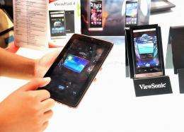 A ViewSonic staff displays a seven-inch tablet called HoneyComb