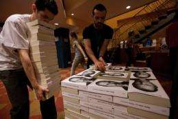 Bookshop employees in Sao Paulo pile up copies of a biography of Apple co-founder Steve Job, in Sao Paulo