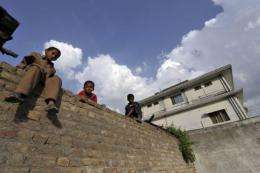 Boys outside the Pakistani hideout of Al-Qaeda leader of Osama bin Laden