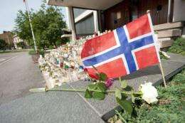 Candles are lit at the doorstep of the Norwegian Embassy in Helsinki