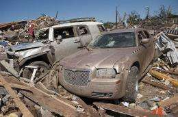 Cars and homes lay in ruins in Tuscaloosa