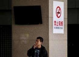 China renews push to ban smoking starting May 1 (AP)