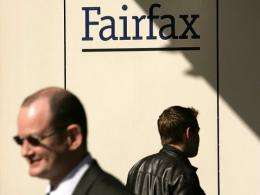 City workers walking past a Fairfax sign in central Sydney