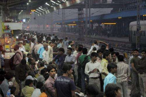 Commuters crowd a platform at a train station in downtown New Delhi