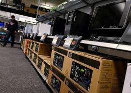 Desktop computers are stocked on a shelf at a Best Buy store