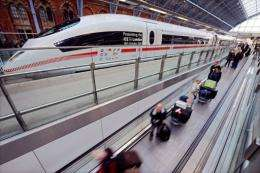 Eurostar passengers pass an ICE high speed train operated by German rail firm Deutsche Bahn