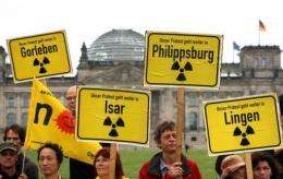 Germany's parliament has approved plans to phase out nuclear energy by 2022