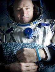 Giffords wristband worn by husband's twin in space (AP)