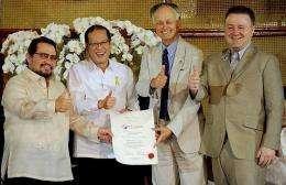 (L-R) Edward Hegedorn, Philippine President Benigno Aquino, Bernard Weber, and Johnpaul De La Fuente