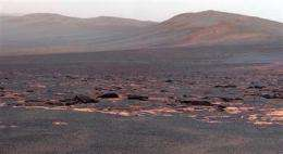 Mars rover Opportunity examining rocks at new site (AP)
