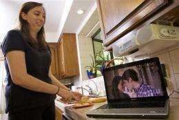 More ads hit online TV as Web audiences grow (AP)