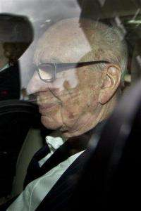 Murdoch pressured to testify in phone hack inquiry (AP)