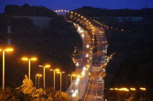 People drive on highway at nightfall in the south of Brussels, near Namur