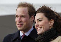 Prince William (L) and his fiancee Kate Middleton