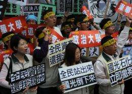 Protesters from central Changhua county display anti-Kuokuang Petrochemical Technology Co, flags