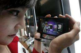 SKorea's LG touts Optimus 3D smartphone for gaming (AP)