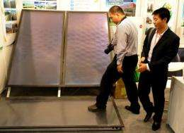 Solar panels on display at a trade exhibition in Beijing last month