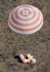 Soyuz lands safely in Kazakhstan, rattles nerves (AP)