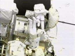 Spacewalking astronauts encounter bolt trouble (AP)